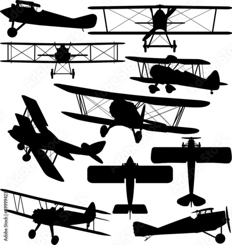 Silhouettes of old aeroplane - contours of biplanes Canvas Print