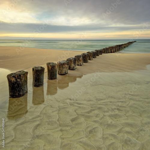 Fotobehang - Morze,  plaża o wschodzie słońca