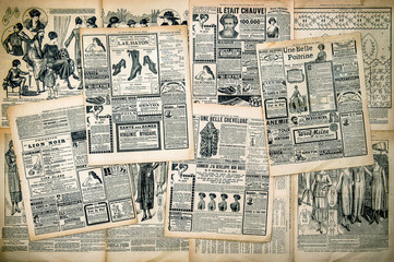 Fototapeta Newspaper pages with antique advertising