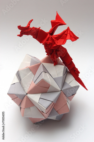 Origami dragon on paper ball Poster