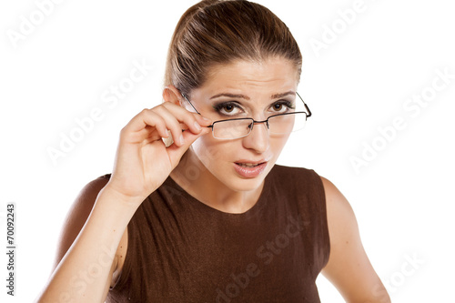 Fotografie, Obraz  young woman with glasses with a questionable gesture
