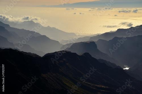 Mountainous silhouette of Gran canaria island at sundown