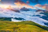 Beautiful foggy sunrise in the Italian Alps. Dolomites, South Ty