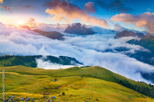 Beautiful foggy sunrise in the Italian Alps. Dolomites, South Ty