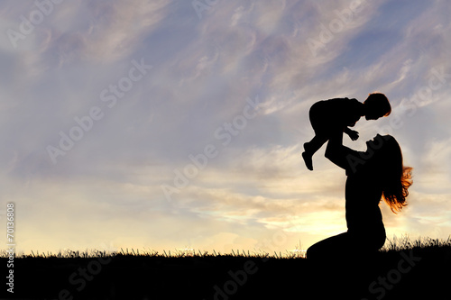 Fotografie, Obraz  Silhouette of Happy Mother Playing Outside with Baby