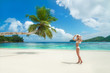 Blonde woman at beach Baie Lazare at Mahe, Seychelles