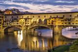 Ponte Vecchio bridge in evening illumination, Florence, Italy