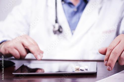 Fototapeta Male Doctor Filling The Medical Form obraz na płótnie