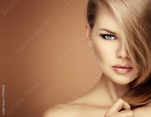 Fotografie, Obraz  Salon hairstyle model. Young woman with magnificent hair