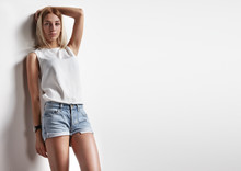 Beauty Woman Posing In Jeans Shorts And White Top