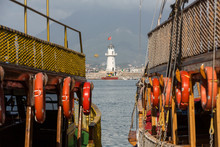 Vintage Sailships And Lighthouse In The Port Of Alanya, Turkey.
