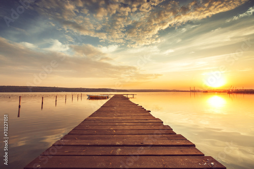 Foto op Aluminium Diepbruine Beautiful cloudscape over the lake, sunset shot