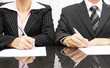 businesswoman and businessman signing contract after negotiation