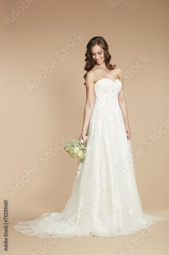 Young bride in wedding dress, studio shot . - Buy this stock photo ...
