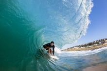 Surfing Inside Crashing Wave