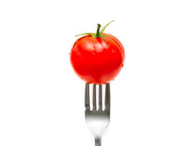Tomato And Fork Isolated On Wh...