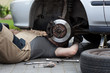 Mechanic repairing car wheel