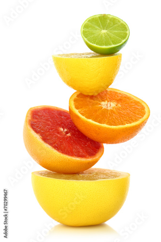 Fresh citrus fruit in a row on white background Fototapet