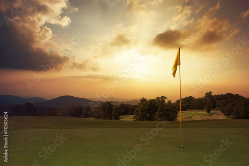 Spoed Foto op Canvas Golf Mountain sunrise at the golf course