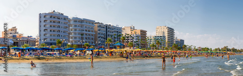 Photo  LARNACA, CYPRUS - 20 AUGUST 2014: People on the sunny beach of L