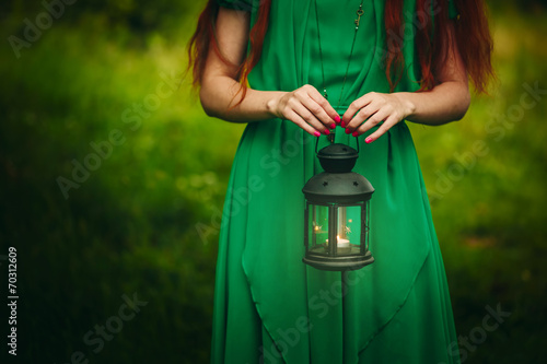 Photo  Woman holding lantern with candle