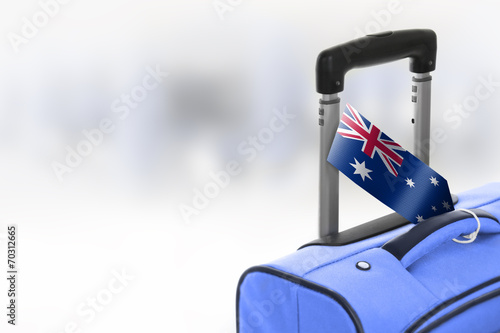 Destination Australia. Blue suitcase with flag. Slika na platnu