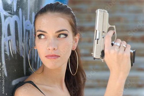 Canvas Print beautiful sexy girl holding gun