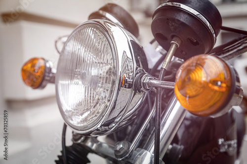 close up of a motorcycle headlight with blinker light Wallpaper Mural