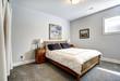 Bedroom in grey tones with wooden bed