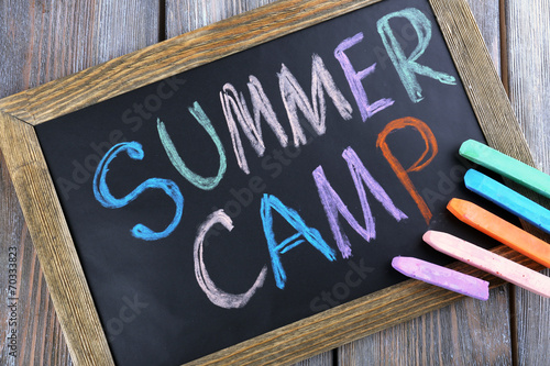 Fotografering Text Summer camp written with chalk