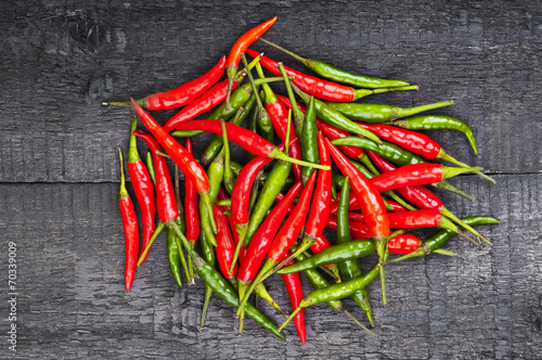 Fototapety, obrazy: Heap of hot peppers on wooden background