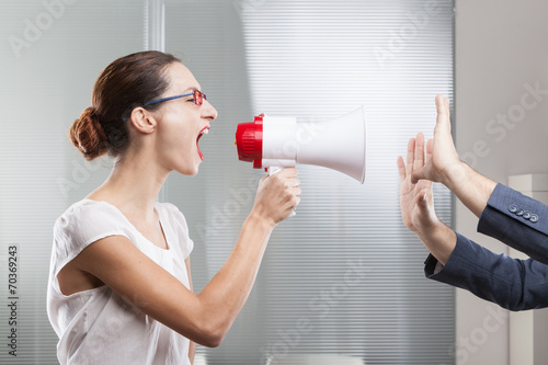 Businesswoman shouting in megaphone Canvas Print