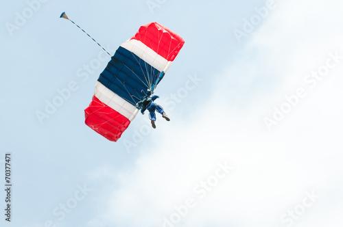 Foto op Canvas Luchtsport Parachute descending under the clouds