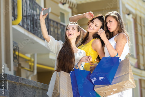 Photo  Happy selfie during the shopping. Three great looking pretty gir