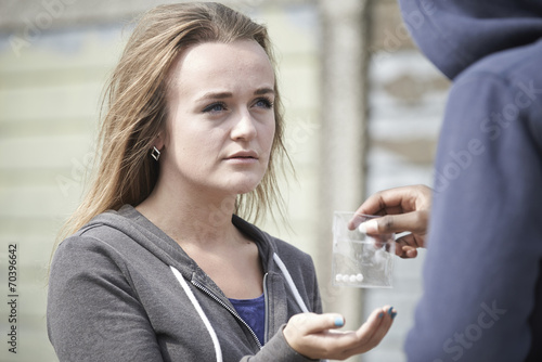 Fotografija  Teenage Girl Buying Drugs On The Street From Dealer