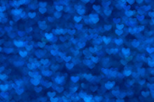Defocused Abstract Blue Hearts Light Background