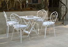 Table And Chairs In Retro Style