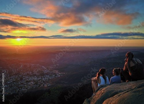 Fotografie, Obraz  Hikers Watching a Colorful Sunset over San Diego, California