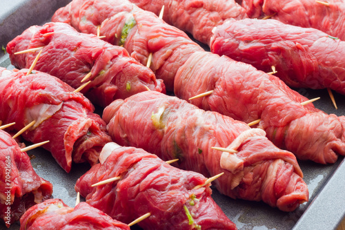 Fototapeta beef rolls stuffed with bacon ready to be cooked obraz