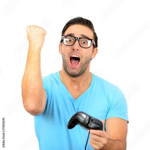 Fotografering  Portrait of handsome man holding joystick for video games agains