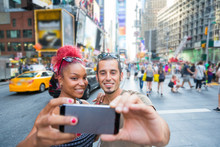 Young Couple Taking Selfie In ...