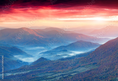 Panorama of the autumn mountains. Foggy mogning.