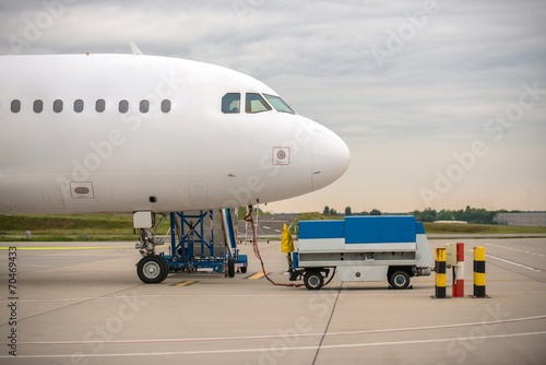 Tuinposter Helicopter White cargo plane at airport