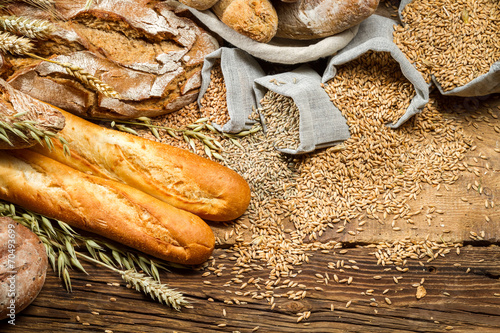 Fototapety, obrazy: Various kinds of whole wheat bread on old wooden table