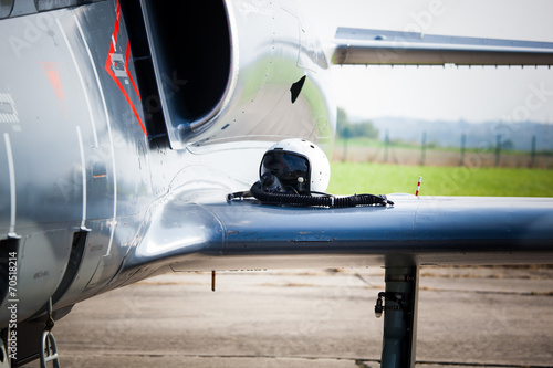 Detail of military fighter/interceptor/jetplane jet engine and wing