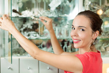 Woman Is Arranging Jewelry In ...