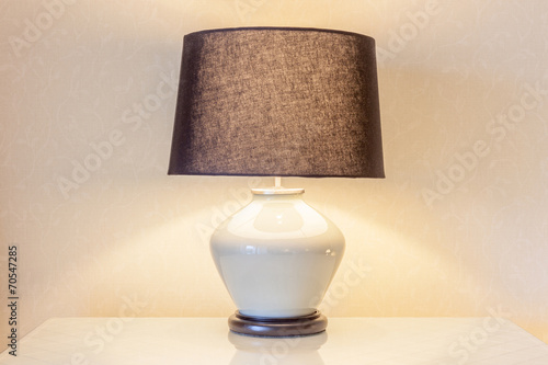Fotografie, Obraz  Table lamp and its shadow on wallpaper in the bedroom