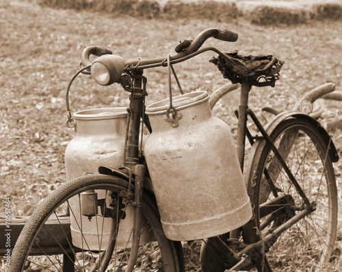 Tuinposter Fiets Rusty bike of a milkman of the last century with two bins