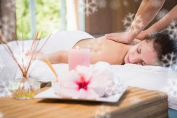 Obraz na płótnie Canvas Attractive woman receiving back massage at spa center