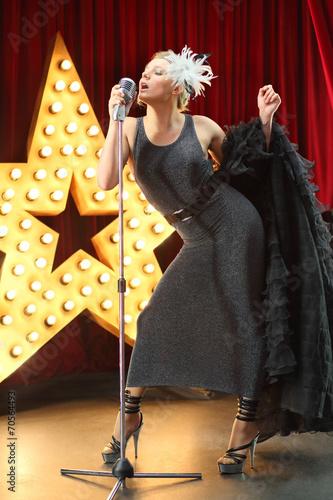 Photo  Beautiful actress sensual singing into a microphone